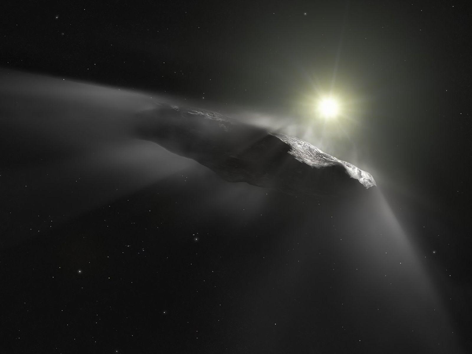 O asteroide de formato estranho 'Oumuamua, visto aqui numa ilustração, foi a primeira rocha espacial conhecida ...