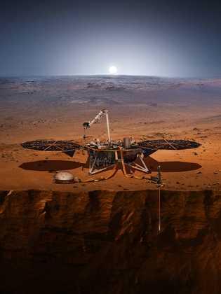 Esta ilustração mostra a sonda InSight na superfície de Marte, com o sismómetro e o sensor ...