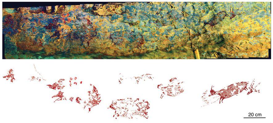 O painel de arte rupestre estende-se por mais de 2 metros de uma gruta em Leang ...