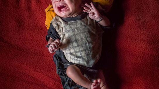 Um bebé, ainda sem nome, com 15 dias de idade. Sem cidadania concedida pela Birmânia ou ...