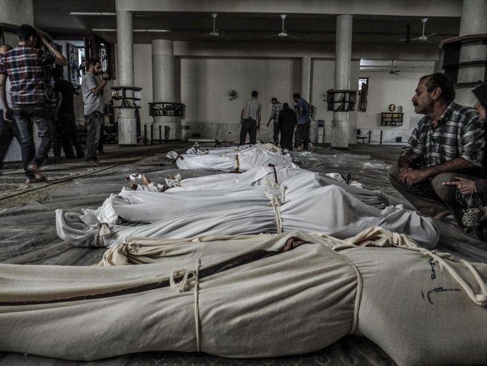 No dia 21 de agosto de 2013, um ataque com armas químicas, feito em Ghouta, nos ...