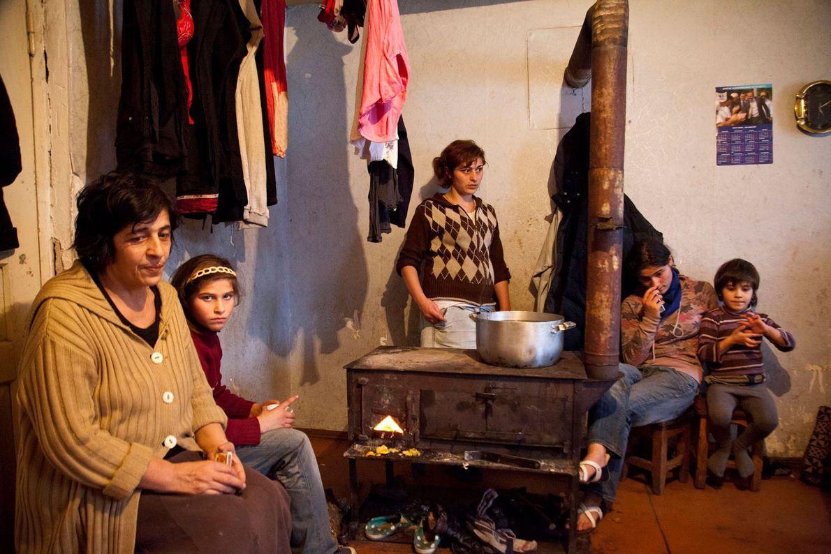 Família de um mineiro na sua residência