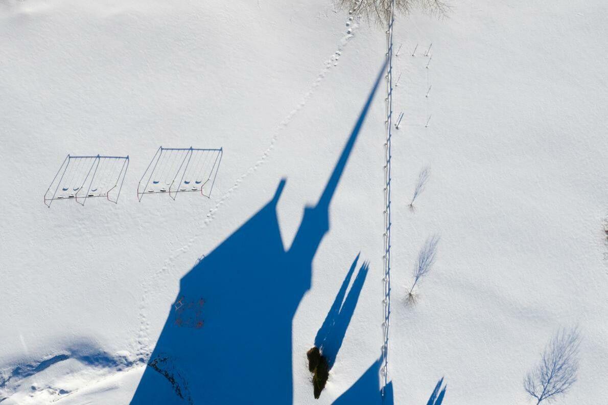 Em Vermont, a câmara municipal de Granville destaca-se na neve. Para captar sombras longas e dramáticas, ...
