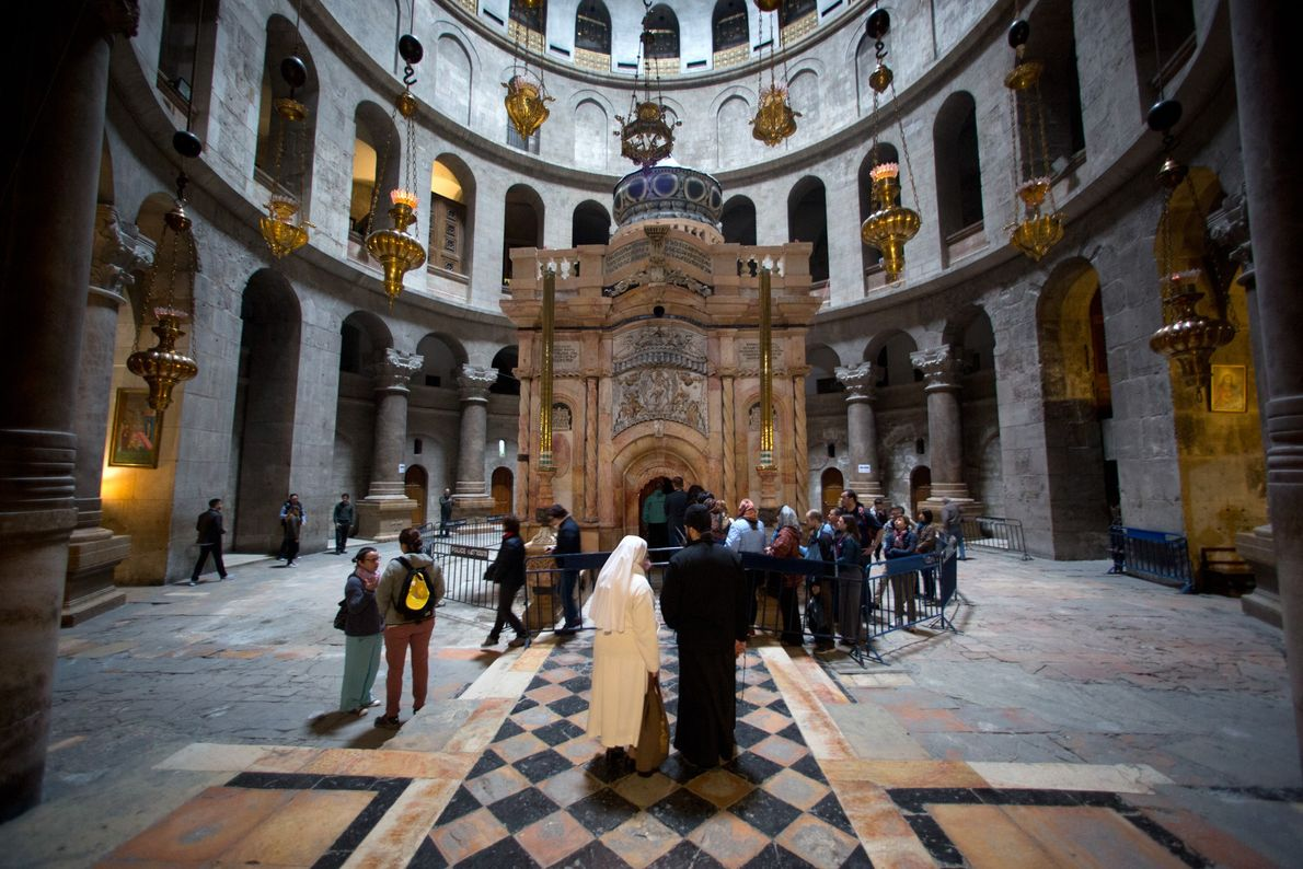 People line up to visit the renovated Edicule, the shrine that houses what is believed to ...