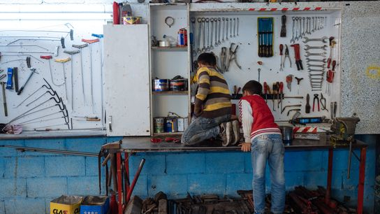 Until recently, Mahmoud (at left) worked in a mechanic's garage from 8 a.m. until 7 p.m. ...