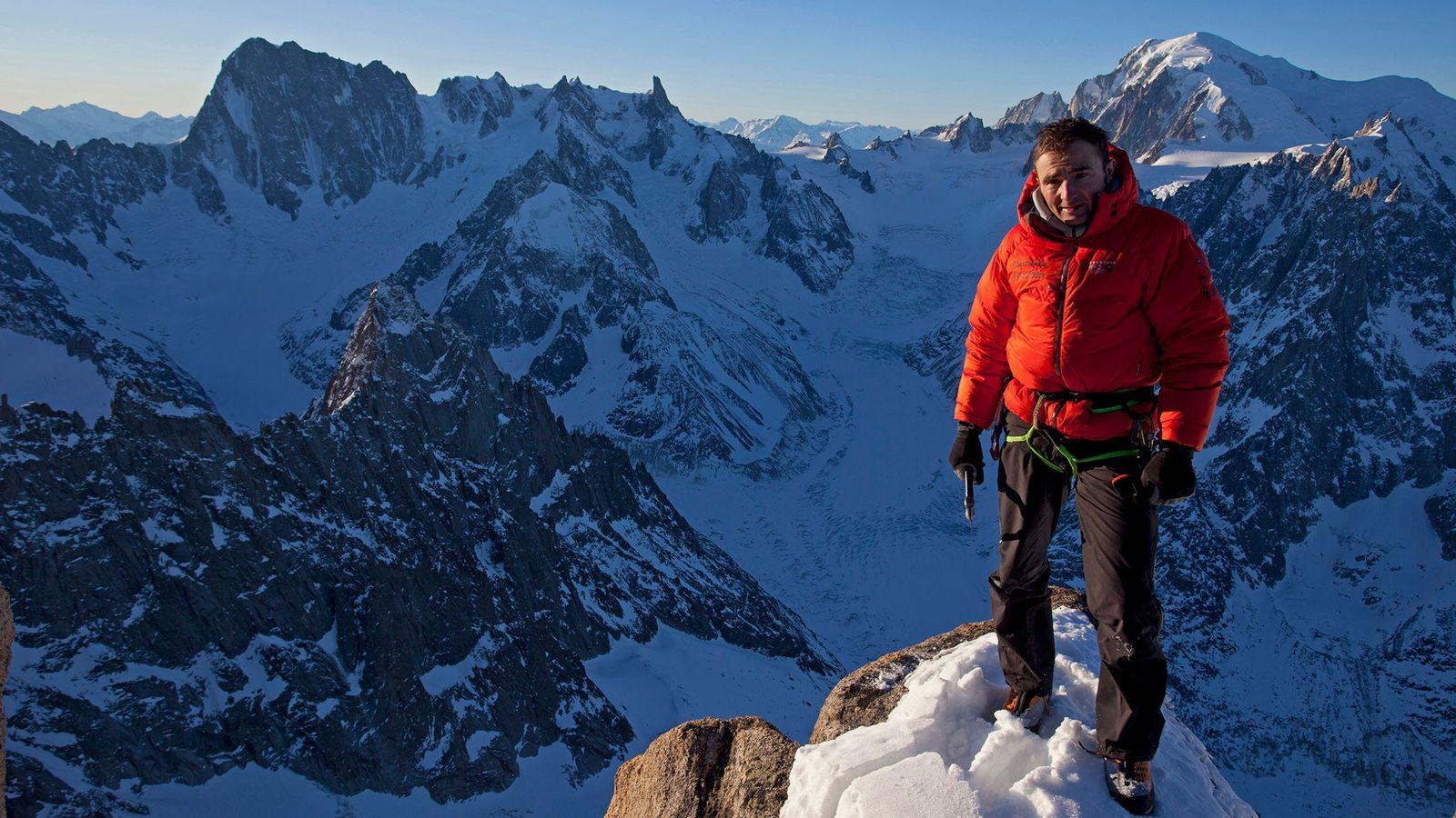 Climber Ueli Steck on the Summit of Les Drus, France